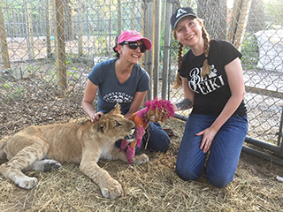 Leah and Kathleen with a Liger at CARE