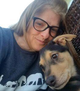 sara teacher denise adleman cuddling her brown and black dog