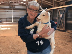 Susan Geiss holding a baby goat